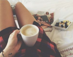 Stop being hard on yourself - girl drinking coffee snacking