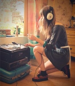 the first year of college - girl listening to records
